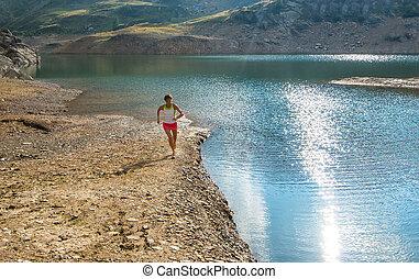 Running near mountain lake