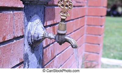Running old rusty water tap - Vintage outdoor tap