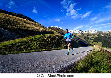 Running on an uphill road in the high mountains