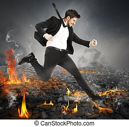Running on hot coals - Determined businessman runs quickly...