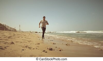 Running on the beach in slow motion