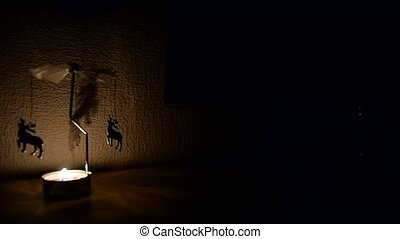 running on the wall. The light from the candles. The feeling of celebration and comfort