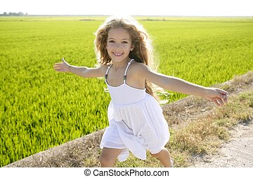 running open arms little happy girl in meadow track - ...