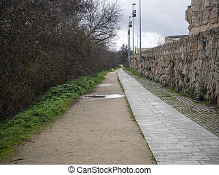 Running path next to the river in a city park