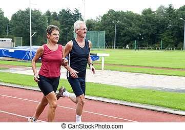 Running Pensioners - Two running pensioners having a healthy...