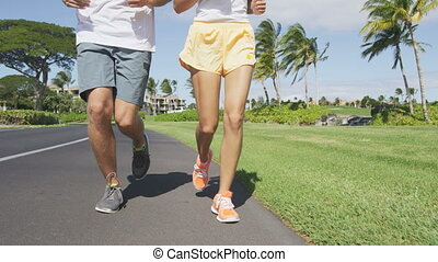 Running People. Low section of multiethnic young couple ...