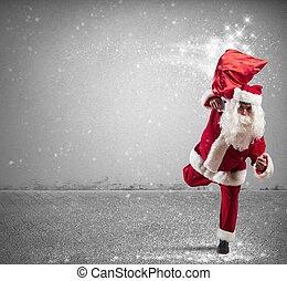 Running Santa Claus with magic gifts