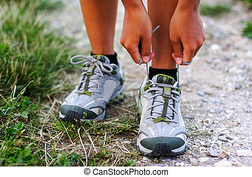 Running shoes being tied by woman getting ready for jogging....