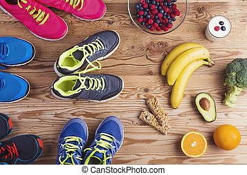 Running shoes on the floor - Running shoes and healthy food...