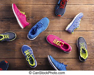Running shoes on the floor - Various running shoes laid on a...