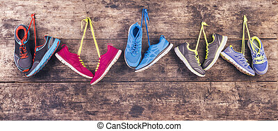 Running shoes on the floor - Five pairs of various running...