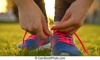 Running shoes - woman tying shoe laces