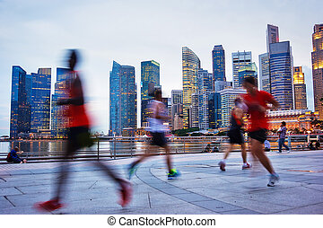 Running Singapore - People runing in the evening in...
