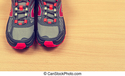 Running sneakers on wooden background