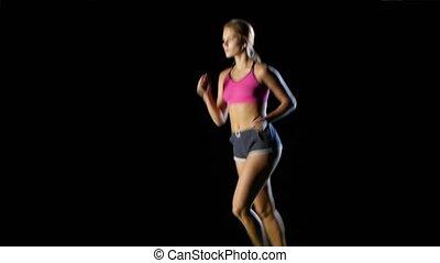 Running sport girl. Front view. Black screen - Active...