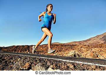 Running sprinting woman - female runner training