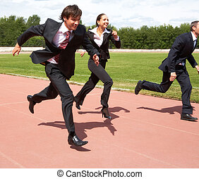 Running - Photo of energetic business people in suits...
