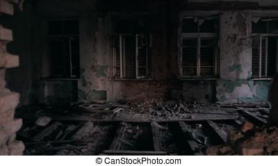 Running through demolished house at evening light
