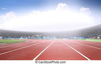 Running track in a stadium under bright sunlight