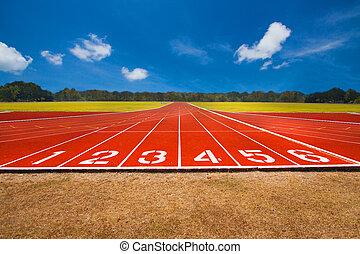 Running track over blue sky