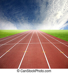 Running track - A deserted athletic running track in a green...