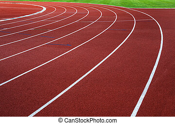 Running track with green grass.
