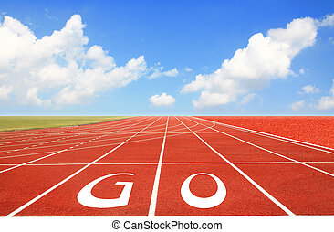 Running track with three lanes over sky and clouds