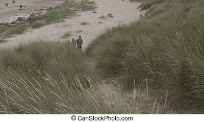 Running Up The Dunes - Two brothers running up the sand...
