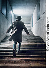 Running up The Stairs - Man with a handgun running up a...