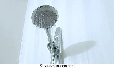 Running water from head shower in bathroom