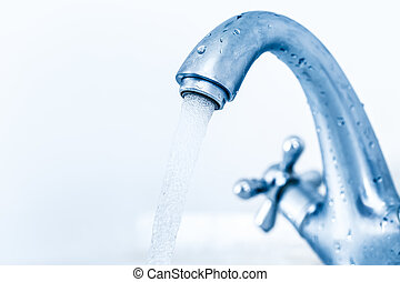Running water tap closeup in toning clean
