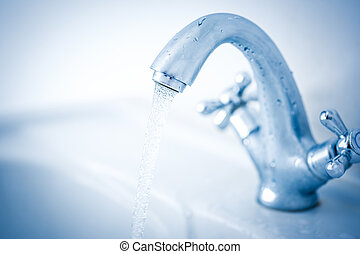 Running water tap closeup