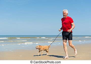 Running with dog at the beach