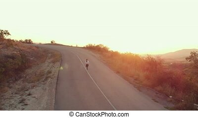 Running woman at morning - Woman running on the road at the...