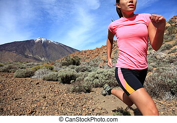 Running. Woman Cross country trail runner running on the ...