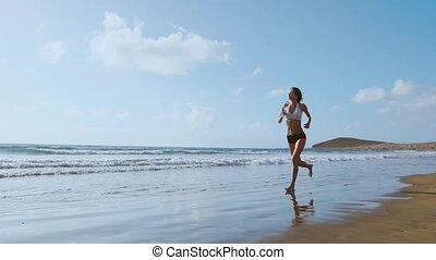 Running woman, female runner jogging during outdoor workout...