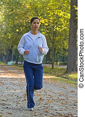 Running woman - Image of a running woman in an autumn park. ...