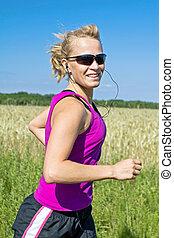 Running woman in summer nature, motion blur