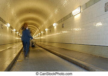 Running - Woman is running in a tunnel