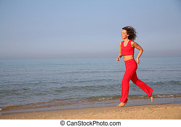 running woman on beach