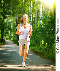 Running Woman. Outdoor Workout in a Park. Full Length Portrait