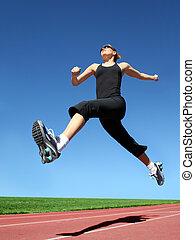 Running woman - Yong woman running on a racetrack