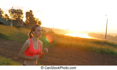 Running woman. Runner is jogging in sunny bright light.