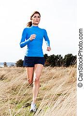 Running woman - An active beautiful caucasian woman running...