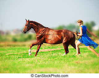 Running young beautiful girl with her horse