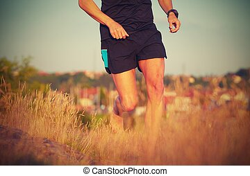 Running - Young man is running on summer meadow - lovely ...