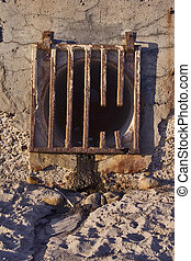 Runoff Grate - Broken rusted runoff grate at the beach
