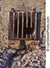 Runoff Grate - Broken rusted runoff grate at the beach