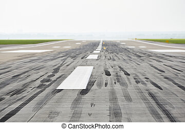 Runway - Airport - Striped line on the runway.