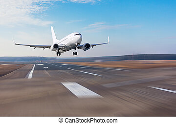 Runway at the airport and the plane flies and landing.